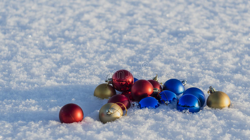 Christmas decorations in the snow stock images