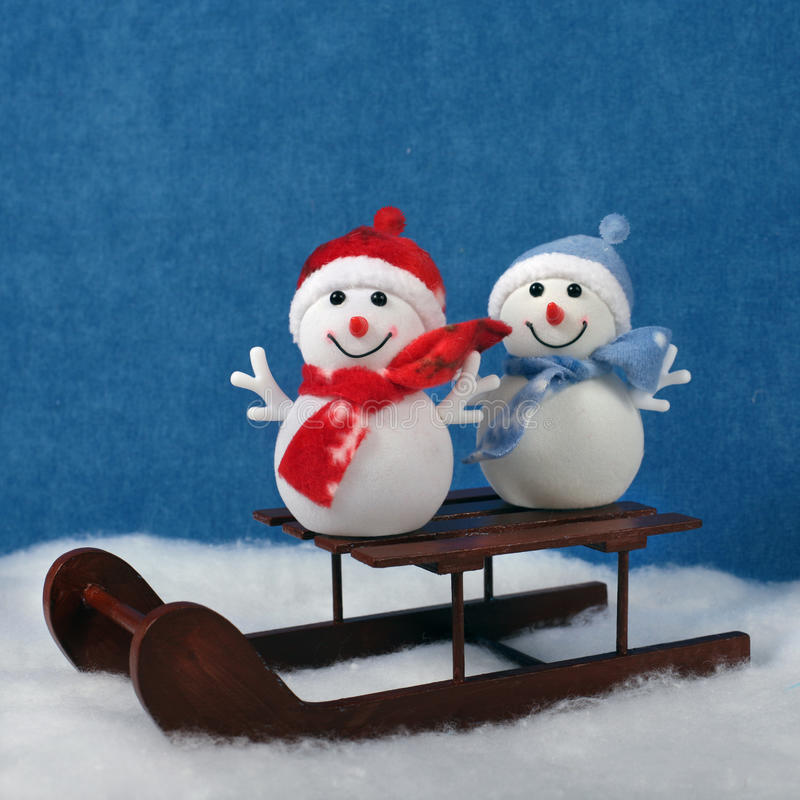 Christmas decorations snowmans on wooden Sledge. Christmas decorations snowmans and snow on wooden Sledge. Winter holidays concept royalty free stock photography