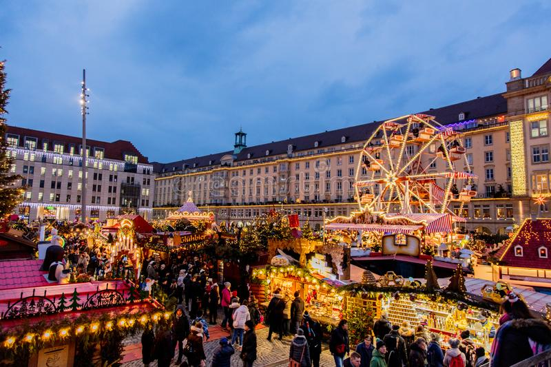 Christmas decorations, toys and scenery houses on the Christmas market in Dresden on the square Altmarkt. Dresden, Germany - december 14, 2018: view of the royalty free stock photography