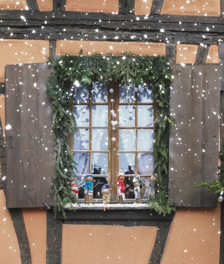 Christmas decorations. Window decorated with toys for the New Year holidays stock photo