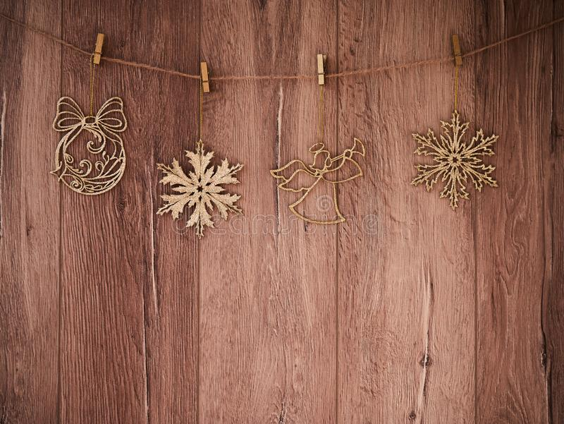 Christmas decorations on a wooden background. New Year decorations and free space for text on a wooden background. Holidays decor. On the clothespins. Vintage royalty free stock images
