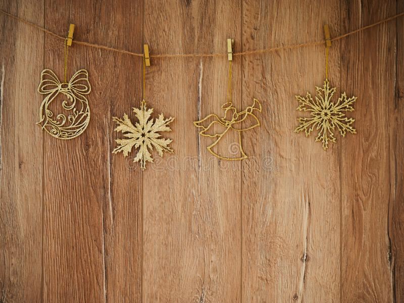 Christmas decorations on a wooden background. New Year decorations and free space for text on a wooden background. Holidays decor. On the clothespins. Vintage royalty free stock photography
