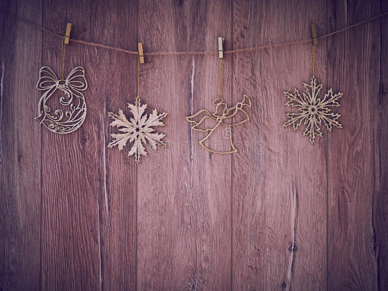 Christmas decorations on a wooden background. New Year decorations and free space for text on a wooden background. Holidays decor. On the clothespins. Vintage royalty free stock photos