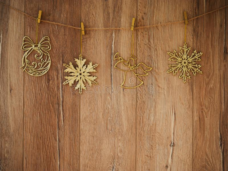 Christmas decorations on a wooden background. New Year decorations and free space for text on a wooden background. Holidays decor. On the clothespins. Vintage royalty free stock photo