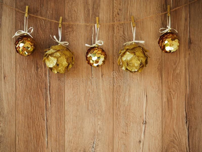 Christmas decorations on a wooden background. New Year decorations and free space for text on a wooden background. Holidays decor. On the clothespins. Vintage stock photography