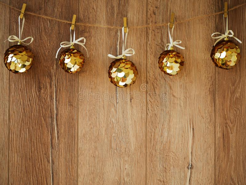 Christmas decorations on a wooden background. New Year decorations and free space for text on a wooden background. Holidays decor. On the clothespins. Vintage stock image