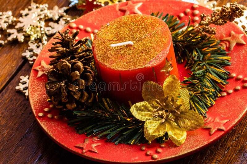 Christmas decorations on wooden board. Christmas concept.  Decorated Christmas candle royalty free stock image