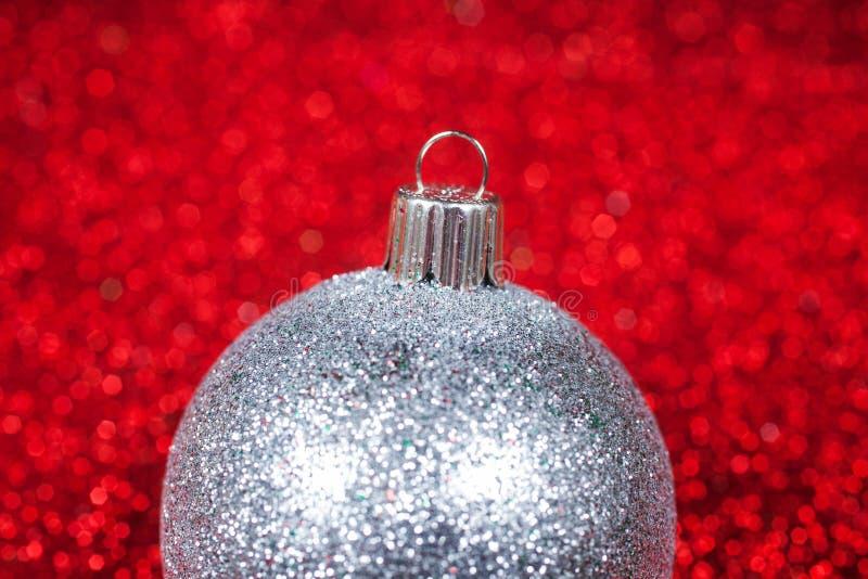 Christmas decorative ball on glitter bokeh. Christmas decorative silver ball on glitter shiny bokeh background. Christmas background royalty free stock photos