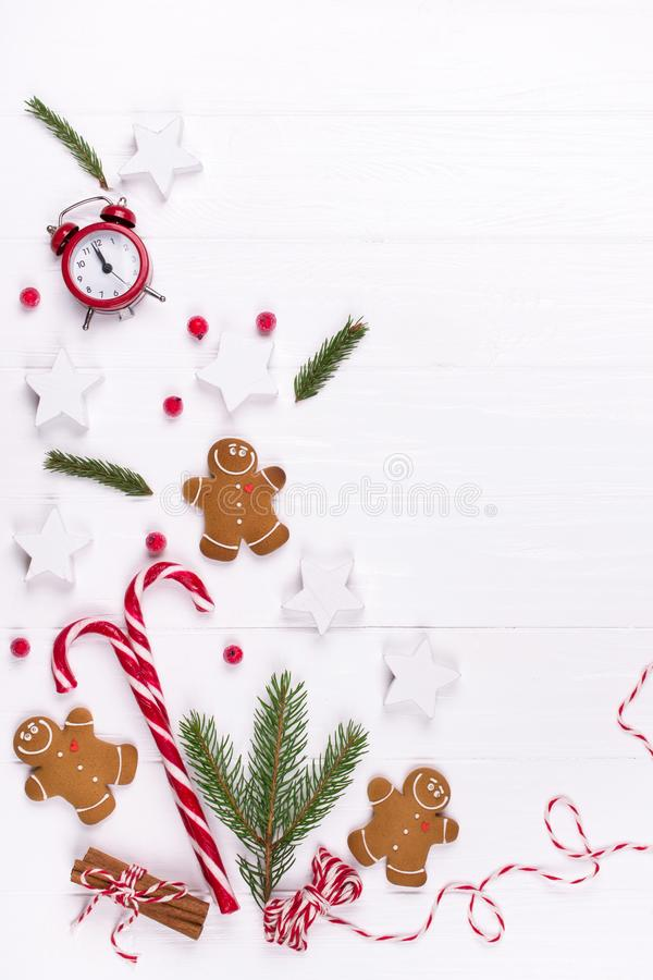 Christmas Decorative Border made of Festive Elements. Smiling gingerbread man, christmas white decorations, pine branches. royalty free stock images