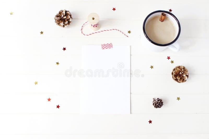 Christmas decorative composition. Blank greeting card, wish list mock-up scene. Frame of pine cones, cinnamon sticks stock image