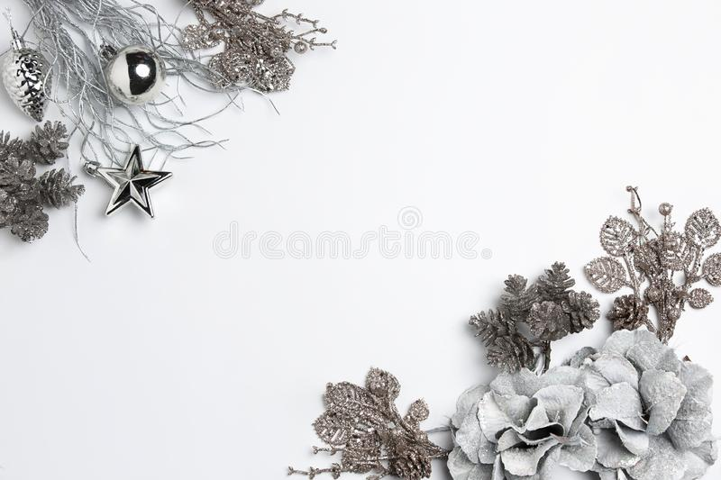 Christmas decorative composition of toys on a white background surrealism. Top view royalty free stock photos