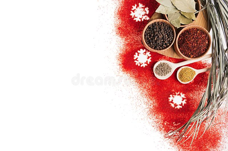 Christmas decorative food border of red chili pepper powder and dry seasoning in wooden bowls. Isolated, top view stock photos