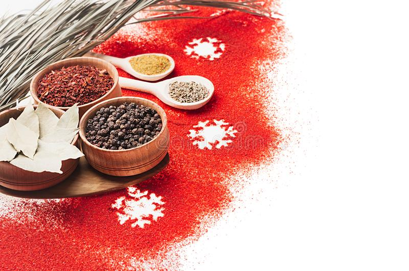 Christmas decorative food border of red chili pepper powder and dry seasoning in wooden bowls, closeup. Christmas decorative food border of red chili pepper stock image