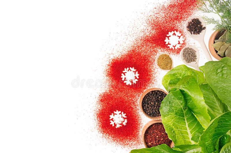 Christmas decorative food border of red chili pepper powder and green fresh spinach. , top view. Christmas decorative food border of red chili pepper powder and royalty free stock photos