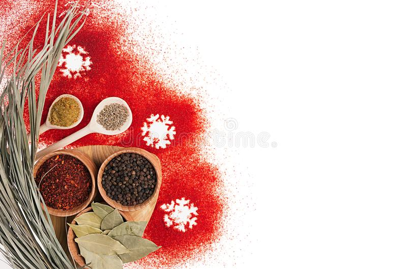 Christmas decorative food border of red chilli pepper powder and dry seasoning in wooden bowls. Isolated, top view. Christmas decorative food border of red stock images