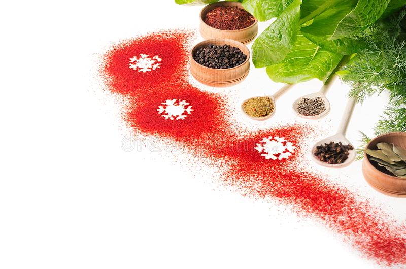 Christmas decorative food border of red chilli pepper powder and green fresh spinach, isolated. Christmas decorative food border of red chilli pepper powder and stock images