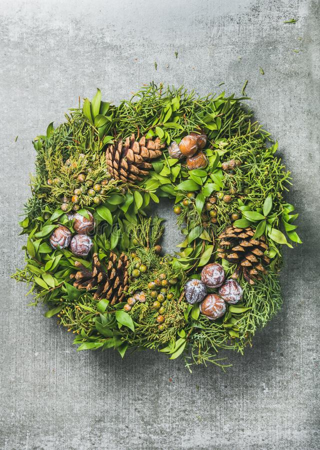 Christmas Decorative Wreath With Bilberries Over Grey