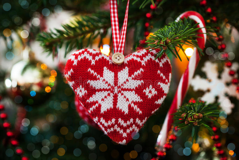 Christmas decorative knitted heart stock photo