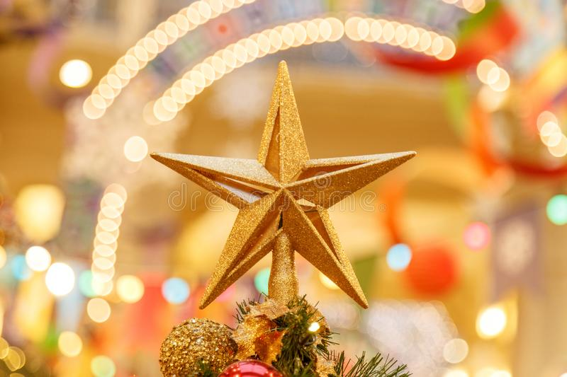 A Christmas decorative - star on the top of A Christmas tree with a beautiful bokeh background royalty free stock photos
