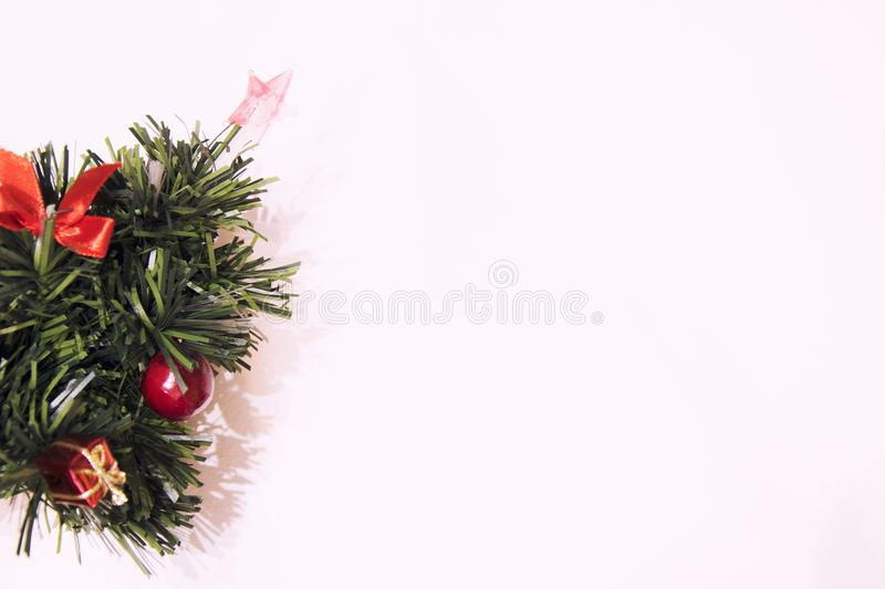 Christmas decorative tree on a white background. New Year and Holidays. Beautiful background with free space royalty free stock photo