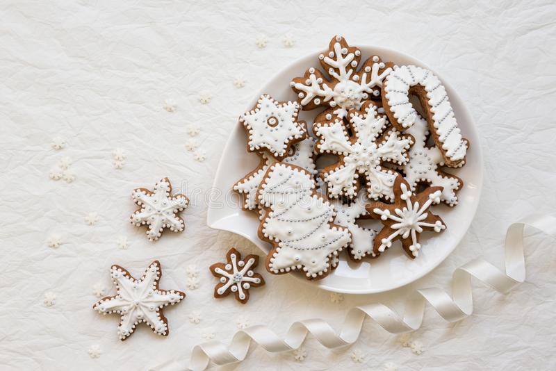 Christmas dekoration with cookies in the shape of snowflakes and stars on a white background stock photography