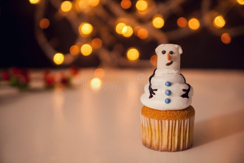 Christmas Dessert. Snowman Cupcake. Copy Space royalty free stock photo
