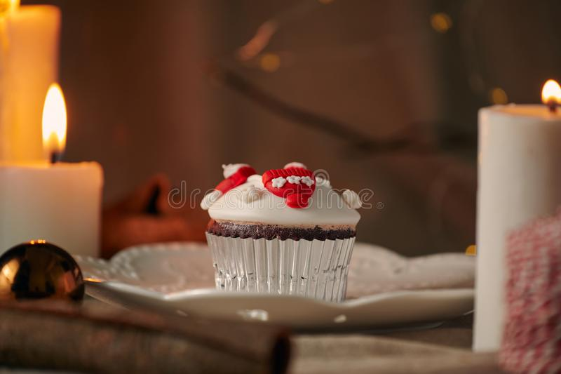 Christmas Dessert. Snowman Cupcakes. Homemade Christmas cupcake with traditional red green decorative stock photos