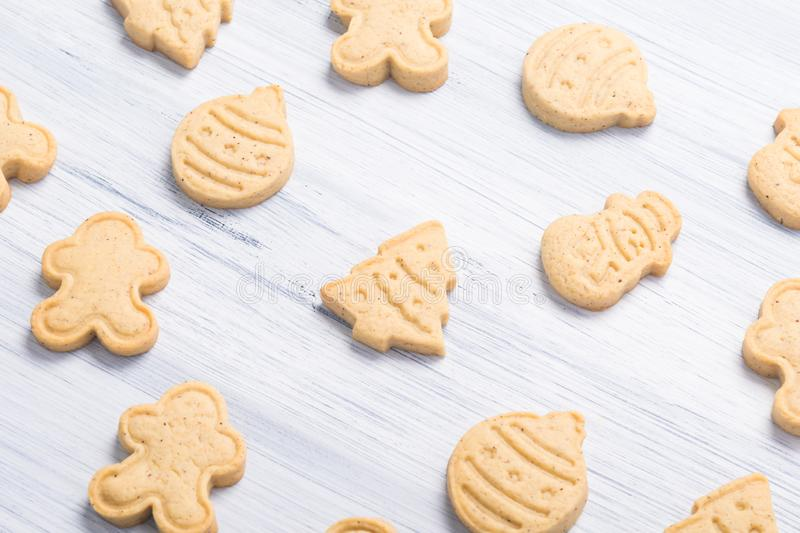 Christmas different shaped cookies on a light gray background royalty free stock images
