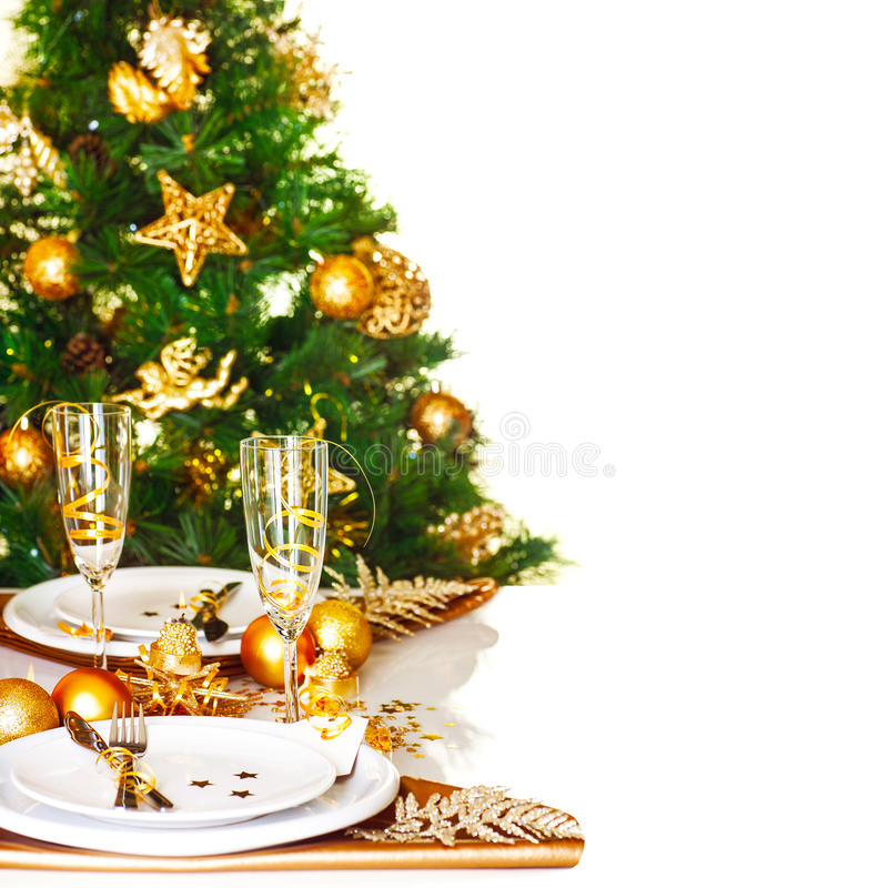 Christmas dinner border. Photo of Christmastime table setting border, beautiful decorated Christmas tree isolated on white background, romantic holiday dinner royalty free stock images