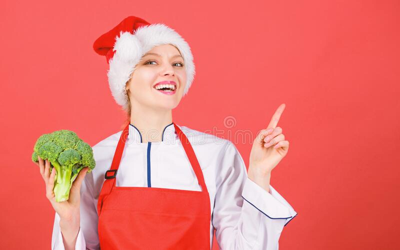 Christmas dinner ideas. Christmas menu. Woman chef cooking christmas dinner wear santa hat. Best christmas recipes. Enjoy easy ideas for holiday parties and royalty free stock images