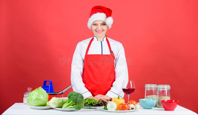 Christmas dinner ideas. Woman chef cooking christmas dinner wear santa hat. Festive menu concept. Best christmas recipes. Enjoy easy ideas for holiday parties royalty free stock photo