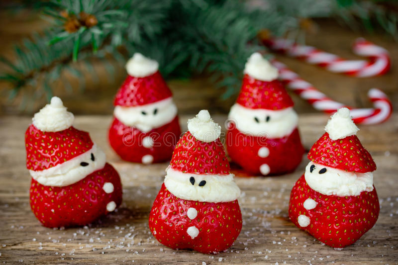 Christmas dinner party ideas for kids - strawberry santa recipe royalty free stock image