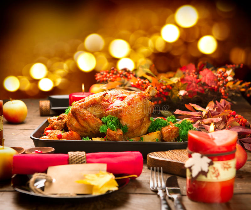 Christmas Dinner. Roasted turkey garnished with potato. Vegetables and cranberries stock photos