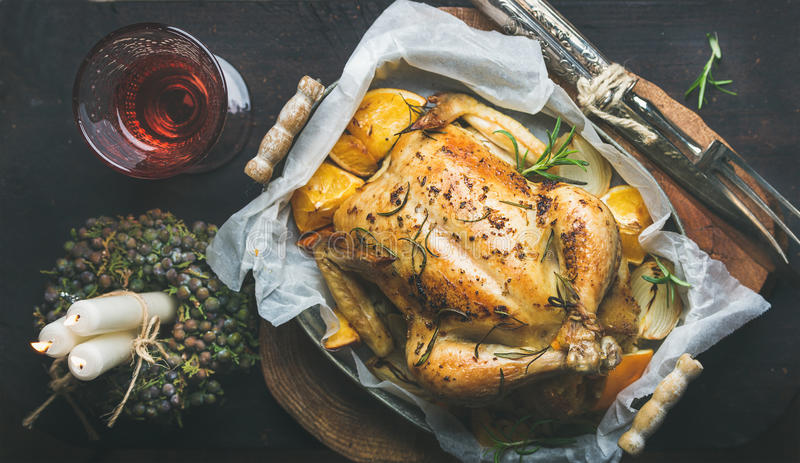 Christmas dinner with roasted whole chicken decorative candles and download christmas dinner with roasted whole chicken decorative candles and wine stock image image forumfinder Image collections