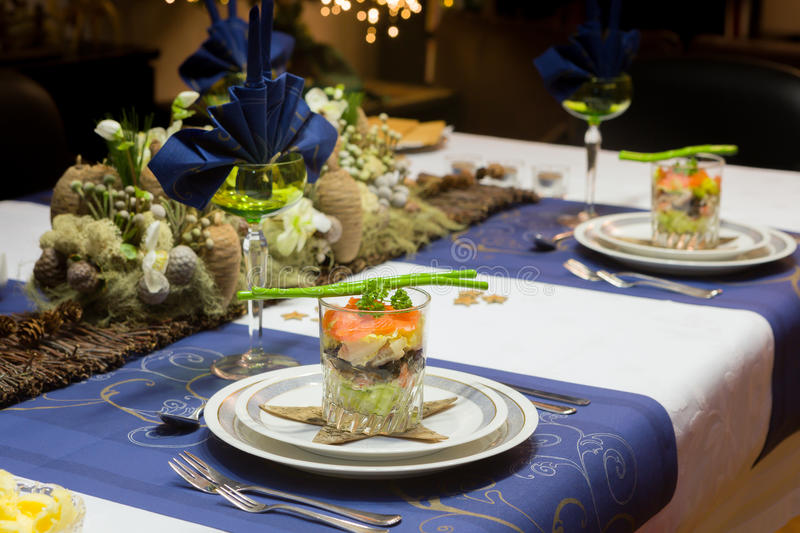 Christmas dinner table in blue royalty free stock images