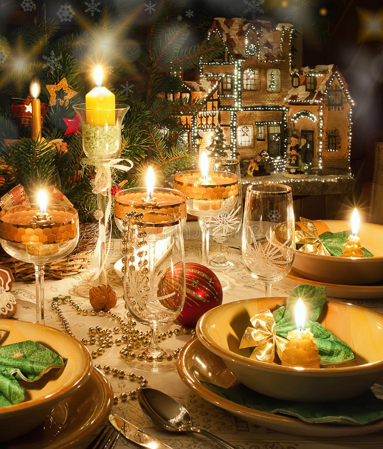 Christmas dinner table with christmas mood. Christmas dinner table with candles with christmas atmosphere