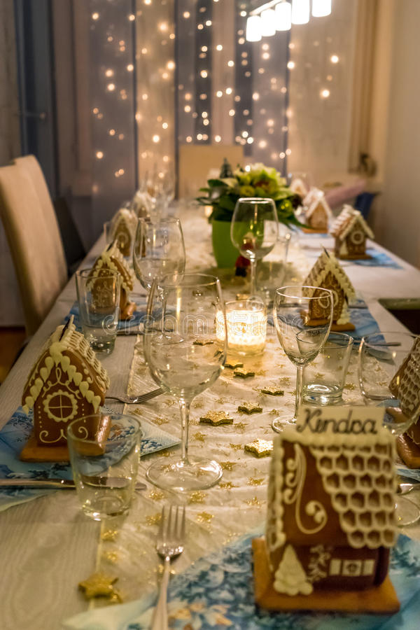 Christmas Dinner Table with Gingerbread Houses Place Cards stock image