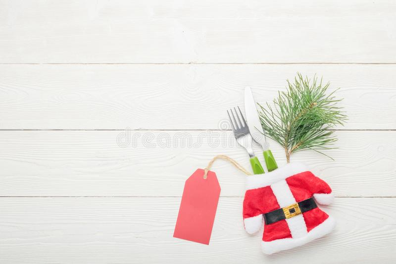 Christmas dinner table setting price concept. Fork with knife royalty free stock image