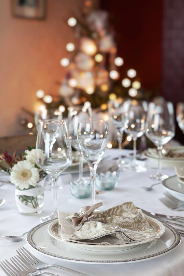 Christmas dinner table in white stock image