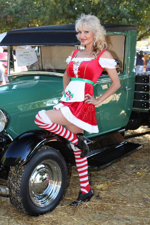 Christmas Dirndl Pinup Woman And Classic Model T Stock Images