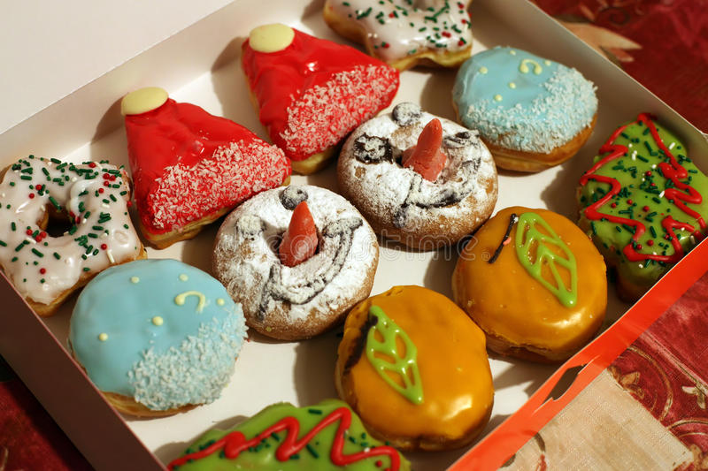 Christmas donuts. Assorted Christmas donuts in a box royalty free stock photo