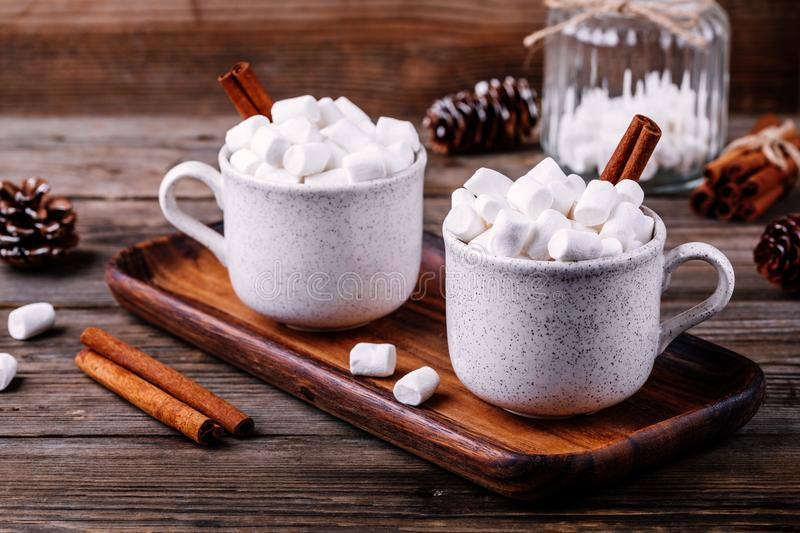 Christmas drink. Hot chocolate with marshmallows and cinnamon on wooden background. royalty free stock photos