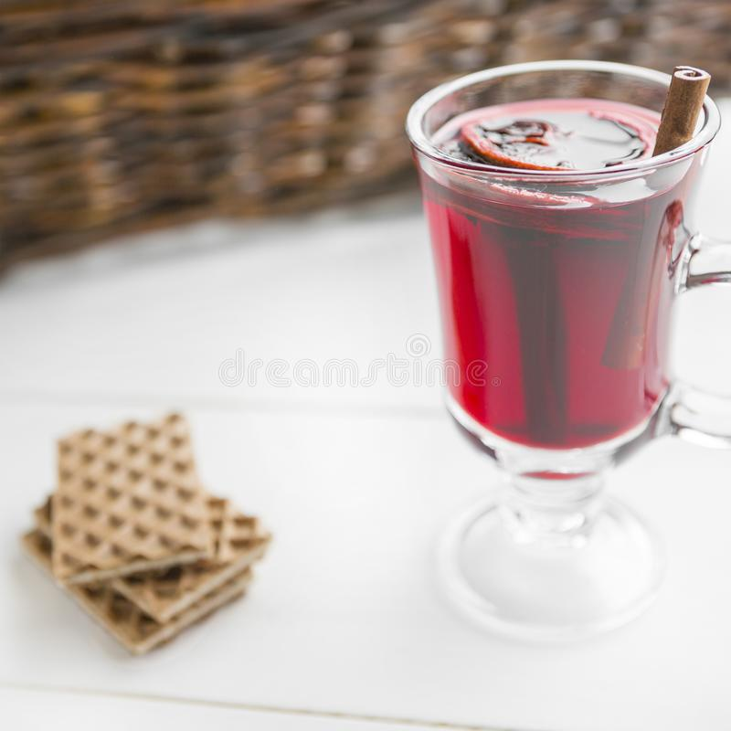 Christmas mulled wine and waffles on white wooden background. royalty free stock images