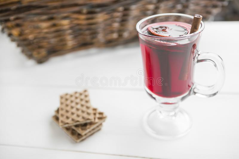 Christmas mulled wine and waffles on white wooden background. stock photos