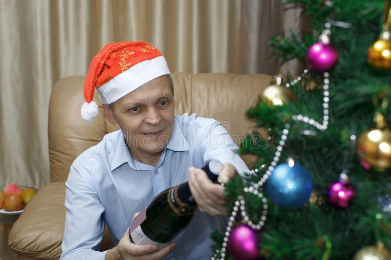 Christmas elderly man, champagne royalty free stock images