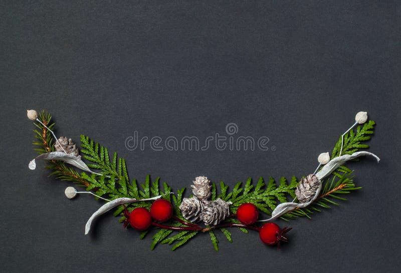 Christmas elegant wreath on black background, top view. Christmas elegant wreath on black background stock images
