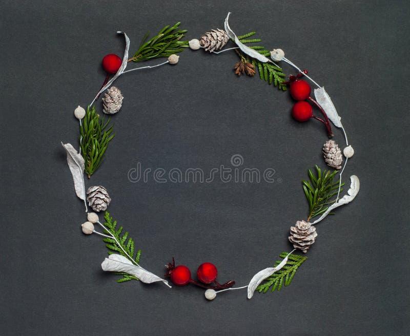 Christmas elegant wreath on black background, top view. Christmas elegant wreath on black background stock image