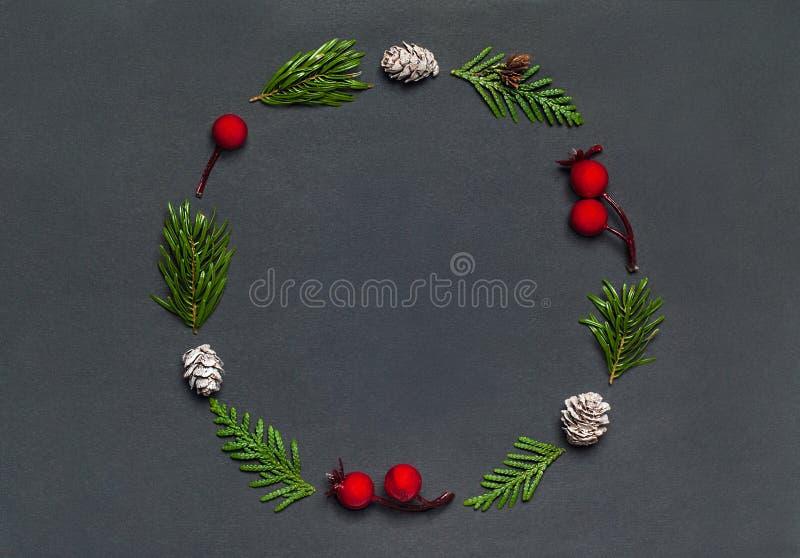 Christmas elegant wreath on black background, top view. Christmas elegant wreath on black background royalty free stock photo