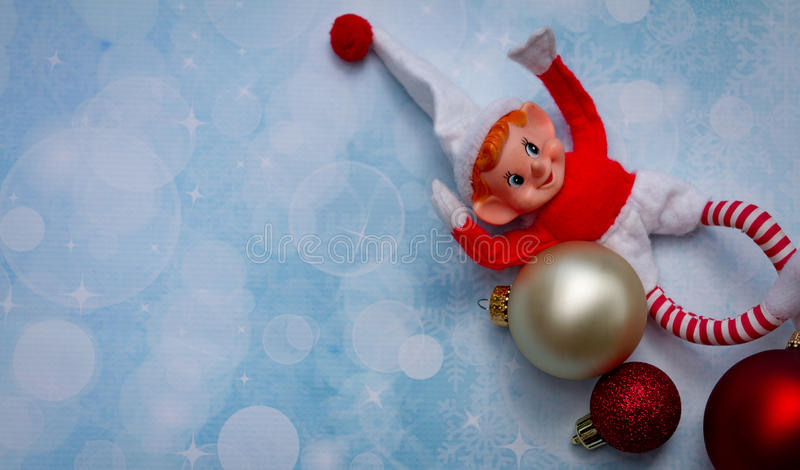 Christmas Elf and ornaments royalty free stock photos
