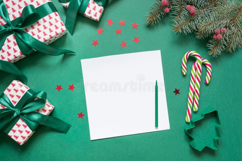 Christmas empty blank letter to Santa or invitation on green. Top view. With copy space royalty free stock image